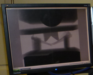 An example of a high flux imaging bay time lapse experiment involving compression